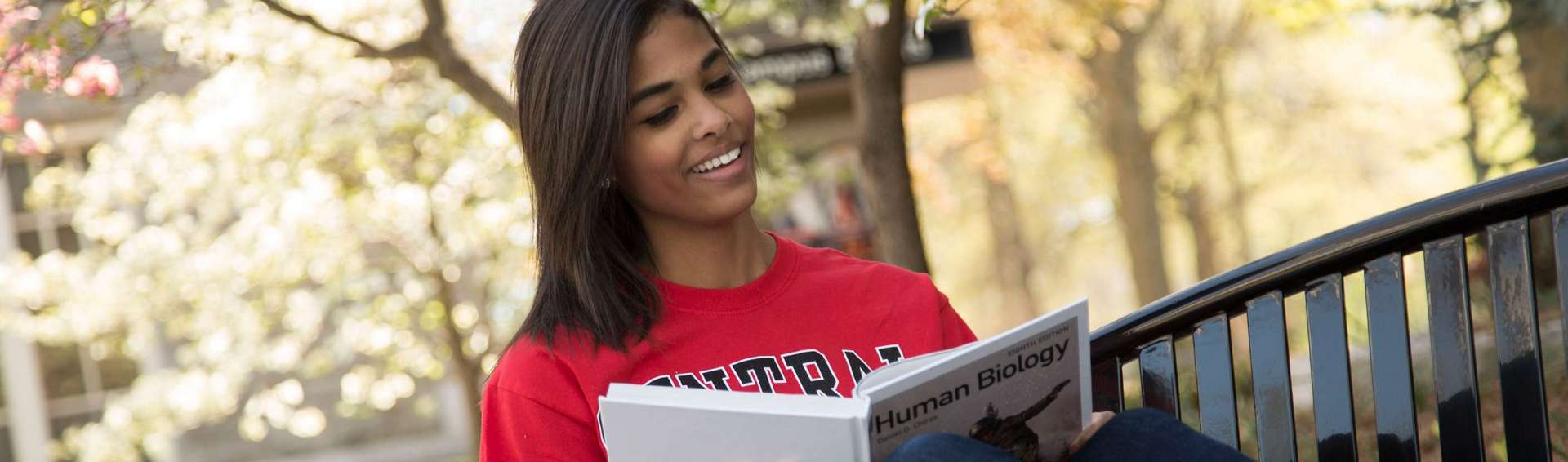 student studying outdoors on UCM Warrensburg campus
