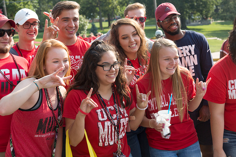 Students posing at Get the Red Out street fair